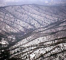 Snow covered Mountains by FOTIS MAVROUDAKIS