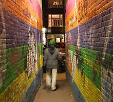 Guy In Colourful Amsterdam Alley by sceneryphotosto