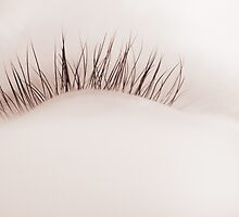Close-up of eyelashes of sleeping baby by Camille Wesser
