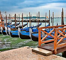 Gondolas at rest..waiting for the rain to stop. by Wilf Kordts
