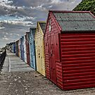 Colourful Beach Huts by Avril Harris