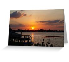Sunset beyond the dock on the bay Greeting Card