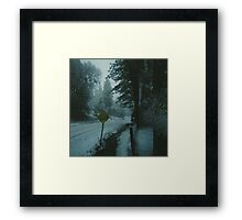 through the snowy road. Framed Print