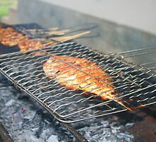 Fish being smoked cooked on BBQ in Bali by petrat