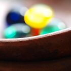 Mancala Beads In Bowl by Cali Maxie
