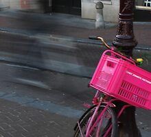 Pink Bike Basket And Passing Shadow by sceneryphotosto
