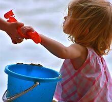 little girl on the beach by Sonia de Macedo-Stewart