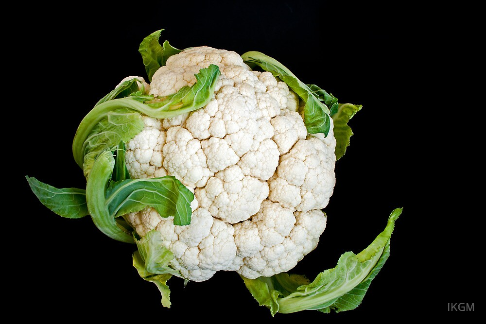 Cauliflower isolated on black  by IKGM