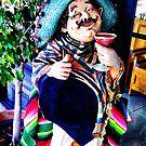 Pedrito enjoying his pomegranate margarita by Roland Pozo
