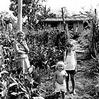 On a bike in Cuba - Family at the Roadside by Philip  Rogan