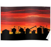 Sunset over wheat silos Poster