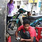 Boy fixing motorbike by eddiebotha