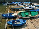 Boats in Dry Dock - Gallipoli Italy by Debbie Pinard