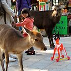 Little girl and toy  Nara, Japan by Joumana Medlej