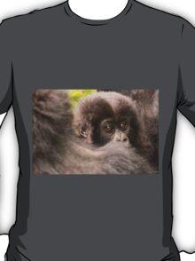 Baby gorilla looks over shoulder of mother T-Shirt