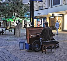 The Piano Man by JaninesWorld