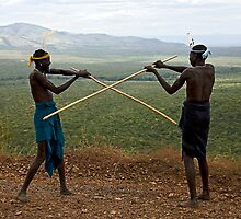 YOUNG MURSI MEN STICK FIGHTING by Nicholas Perry