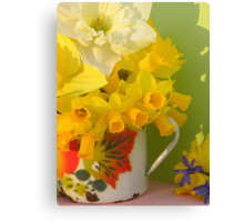 A Cup Of Golden Daffodils Canvas Print