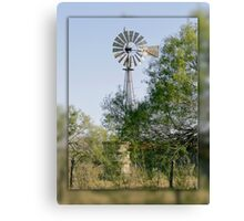 Hawk on a Windmill Canvas Print