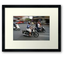 Life rolls by in Ho Chi Minh Framed Print