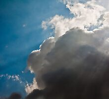 God clouds, sun rays piercing through dense clouds by MuhammadAther
