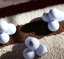Golf Ball Pyramids by daphsam