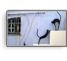 Stunning window and sculptures Canvas Print