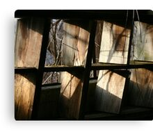 sunlight on some old shelves Canvas Print