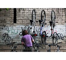 Bicycles on hooks Photographic Print