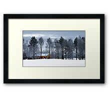 Yellow house in winter time Framed Print