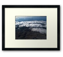 flying over the clouds  Framed Print