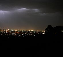 Lightning over the suburbs by stormypeace