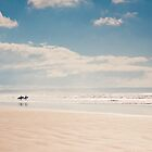 Heading into the surf, Saunton Sands, Devon by Zoë Power