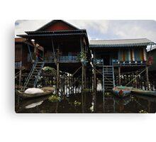 A house on stilts Canvas Print