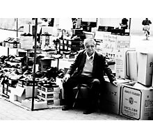 The Shoes Salesman Photographic Print