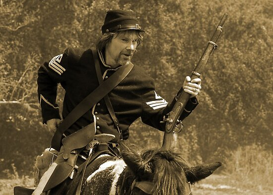 Reloading in sepia by Larry  Grayam