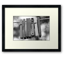 Clothespins on wire Framed Print