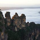 Three sisters view a misty valley by charlienelson