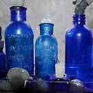 Blue Bottles in Window by Karen Kaleta