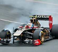 Vitaly Petrov smokes a tyre by Neville Jones