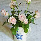 Pink roses in blue and white jug by Margaret Whyte