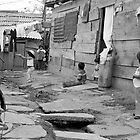 "At Play in the alleys of ""Shantytown"" by photosbytony"