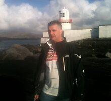 Yours truly near light house Valentia by timbuckley