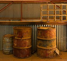 Old drums in the shearing shed by Ian Fegent