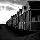 Might need to shelter (B&W beach huts) by Karen  Betts
