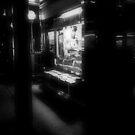 Newsstand at Night, Bleecker Street by APhillips