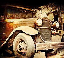 Vintage Ride parked in a barn in rural Pennsylvania  by jenndiguglielmo