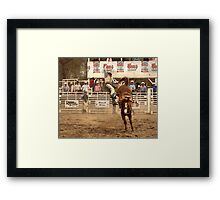 Rodeo Cowboy is Thrown from his Horse Framed Print