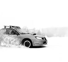 Subaru Snow Drifting by David  Appolonia
