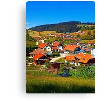 The village and the valley Canvas Print